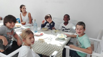 Kids having lunch with friends at Sevilla
