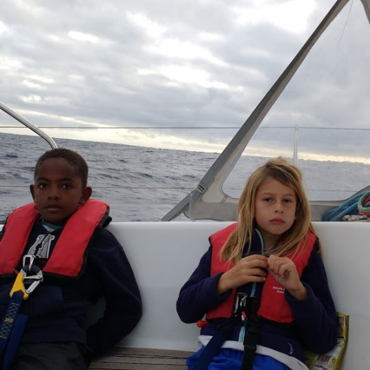 Kids tired sailing in the Atlantic