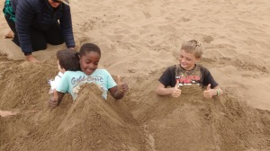 Soledad and Monkey Island crew playing in the sand
