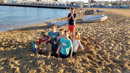 Liveaboard kids dream team playing in the sand