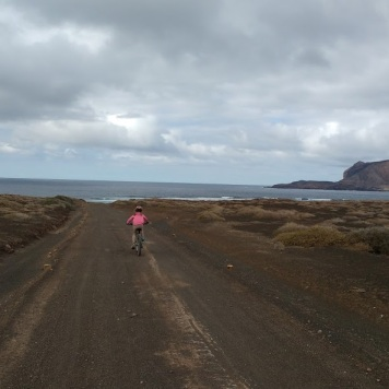 Lucia biking at La Graciosa
