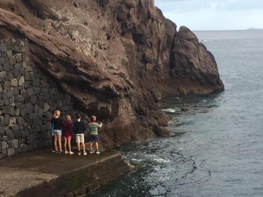 Dunia and Soledad kids watching Madeira coast