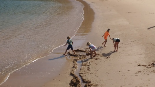 Dunia and Soledad kids playing at Machico beach