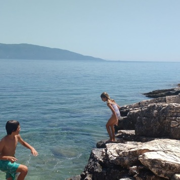 Kids playing at the beach Kefalonia